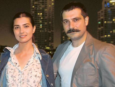 Actors Tuba Buyukstun (left) and Bulent Inal, stars of the Turkish drama Ihlamuralar Altinda