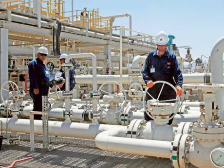 Employees work at the Tawke oil field in the Kurdish region in northern Iraq