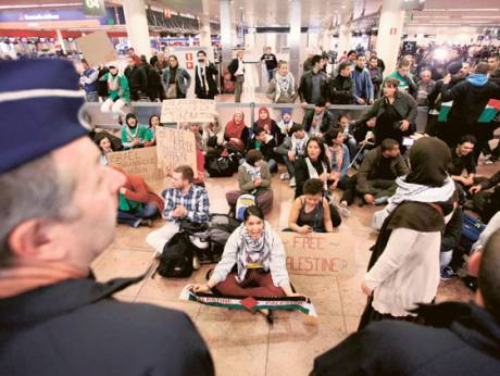 Around 100 pro-Palestinian activists stage a protest at Brussels national airport in Zaventem