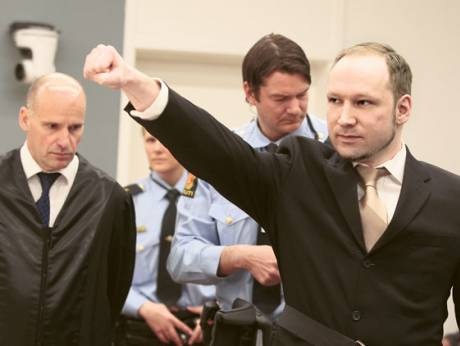 Anders Behring Breivik flashes a right-wing salute as he arrives in court