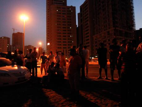 Residents of the building await news about their homes in Al Nahda Park
