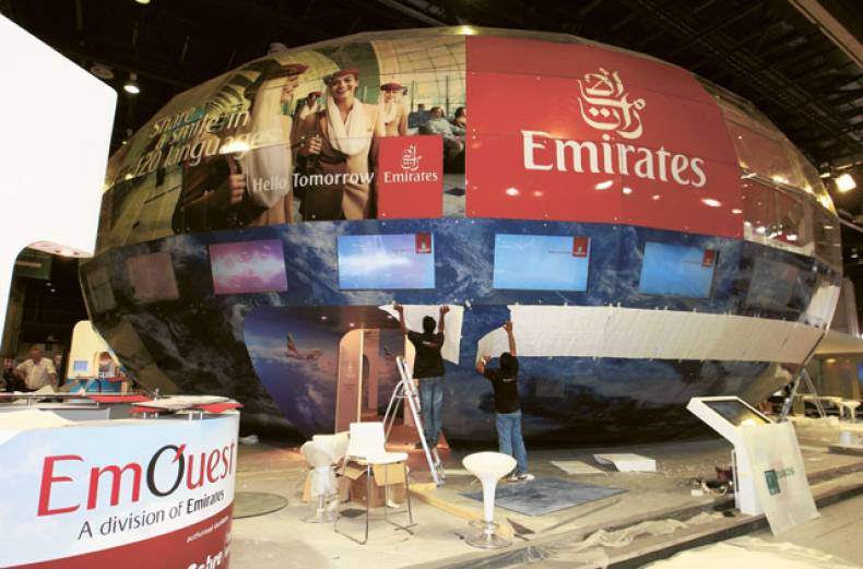workers-prepare-for-the-19th-edition-of-the-arabian-travel-market-at-the-dubai-world-trade-center