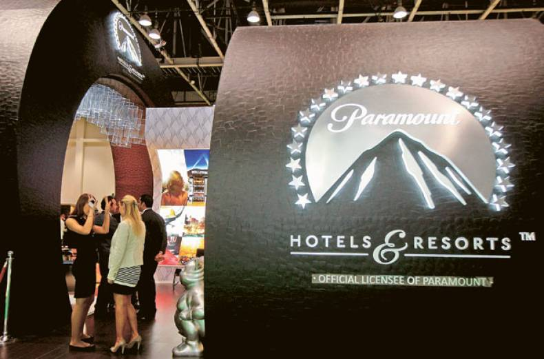 visitors-at-the-paramount-hotels-and-resort-stand-at-the-atm