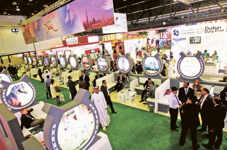 visitors-at-the-definitely-dubai-stand-at-the-arabian-travel-market-2012