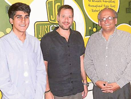 Scholarship winner Aqil Rashid (left) with Mohammad Bitar and Aqil's father Safdar Rashid