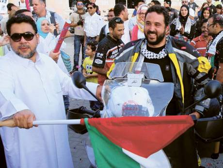 Jubilant Wissam Al Jayyoussi on his bike leaving for 132 days touring 22 countries