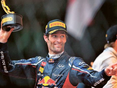 Red Bull's Mark Webber celebrates on the podium after winning the Monaco Grand Prix