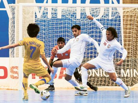 UAE players defend a Thai attack during the AFC Futsal Championship 2012