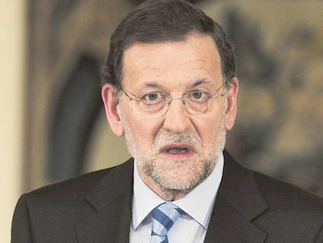 Prime Minister Mariano Rajoy gestures during a press conference at the Moncloa Palace