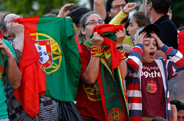 Portuguese soccer fans react during the Euro 2012 quarter final