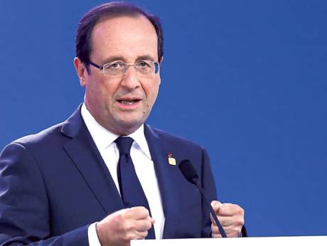 French President Francois Hollande speaks at the European Summit in Brussels