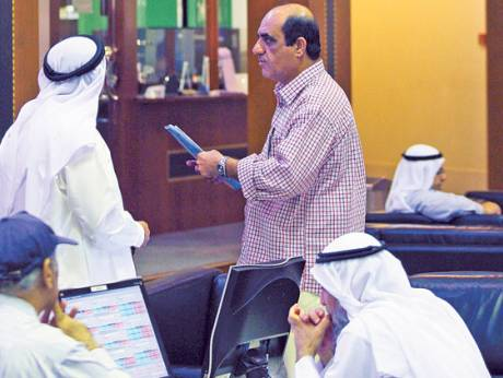 Traders at the Dubai Financial Market