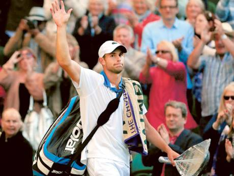 Andy Roddick leaves Centre Court after losing against David Ferrer in the Wimbledon