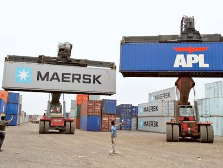 Mobile cranes prepare to stack containers at Thar Dry Port in Sanand, Gujarat