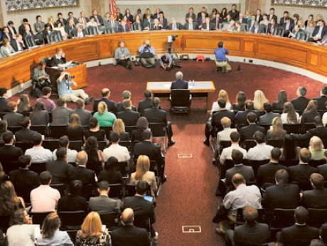 JPMorgan CEO Jamie Dimon (at table, centre) testifies at a Senate Banking Committee hearing