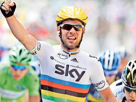 Rider Mark Cavendish celebrates after winning the second stage of the 99th Tour de France race