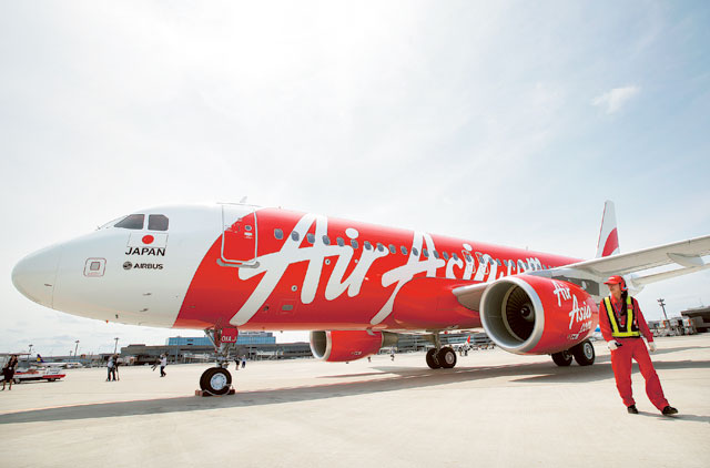 AirAsia Japan Co.'s first Airbus SAS A320 aircraft stands on the tarmac at Narita Airport