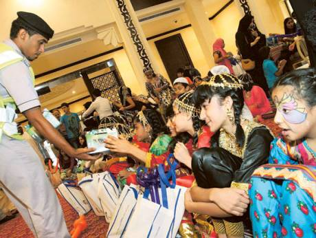 Children share time with the elderly as part of Hag Al Laila celebrations