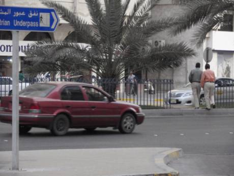 A jaywalker crossing Electra Street in Abu Dhabi