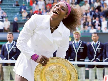 Serena Williams celebrates with the Wimbledon singles crown