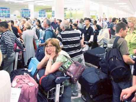 Passengers wait at the Dubai airport terminal