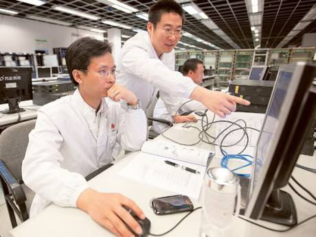 Huawei customers learn to use Huawei technologies in the main building of the training centre