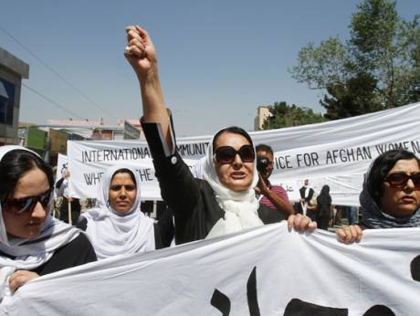 An Afghan protestor shouts slogans