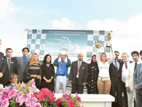 The winners collect their prizes at the Taby racecourse in Stockholm