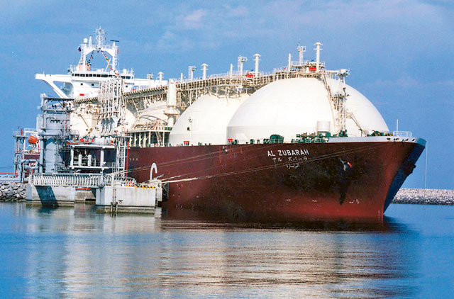 An undated picture shows a Qatari Liquid Natural Gas (LNG) tanker ship being loaded up with LNG