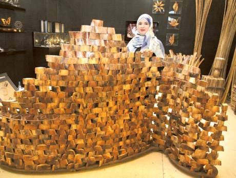 Azza Al Qubaisi showcases a creation she fashioned out of date palm by-products