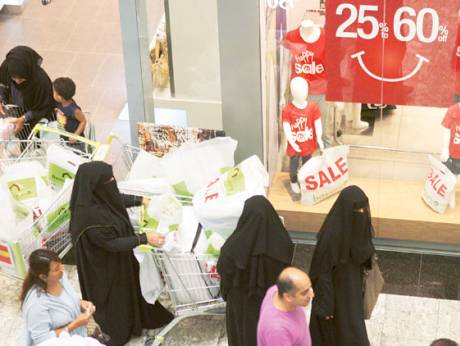 People shop during the Dubai Summer Surprises 2012 at Mirdif City Centre
