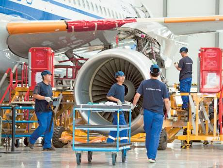 Employees work on the assembly of an Airbus SAS A320 airplane at the company's plant in Tianjin