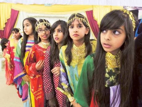 Children in traditional dresses take part at the Liwa Date Festival 2012