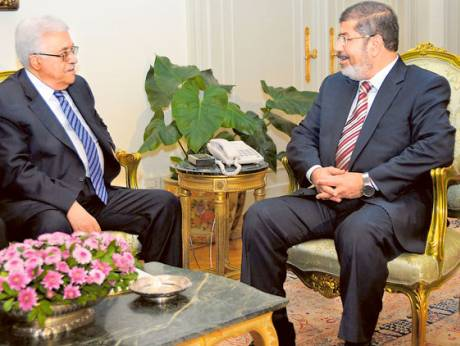 Egypt's President Mohammad Mursi (right) with his Palestinian counterpart Mahmoud Abbas