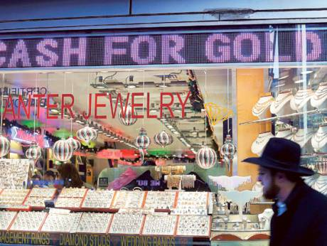 Merchants buy and sell gold and other valuables in the Diamond District in New York
