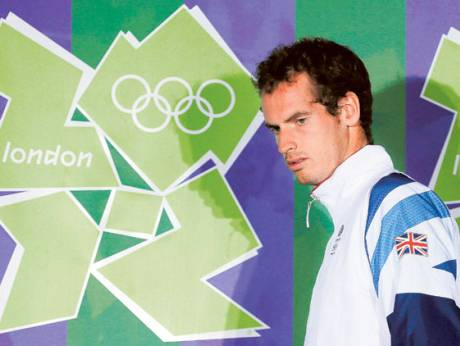 Britain's Andy Murray arrives before a news conference at the All England Lawn Tennis Club