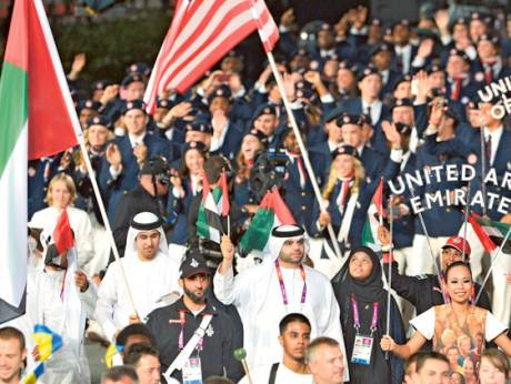 UAE flag bearer Saeed Al Maktoum leads the UAE contingent during the opening ceremony