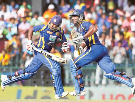 Sri Lanka's batsmen Kumar Sangakkara (right) and captain Mahela Jayawardene