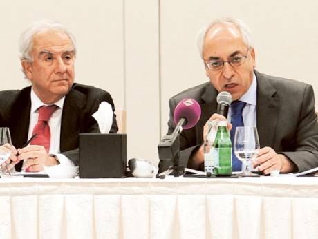 Abdul Basit Sida (right), the head of the Syrian opposition group, speaks