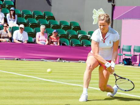 Kim Clijsters of Belgium returns to Roberta Vinci of Italy