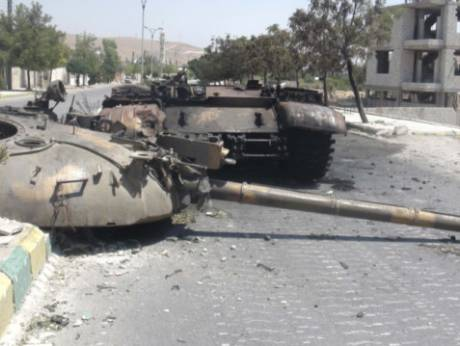 A destroyed Syrian army tank in Damascus
