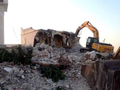 Hardliners use a bulldozer to raze the mausoleum of Al Shaab Al Dahman