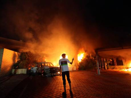 The US Consulate in Benghazi is seen in flames