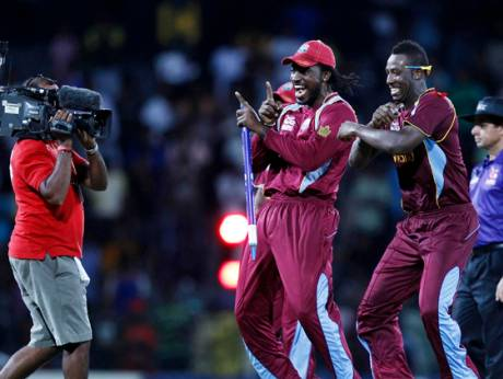 Chris Gayle and Samuel Badree celebrate