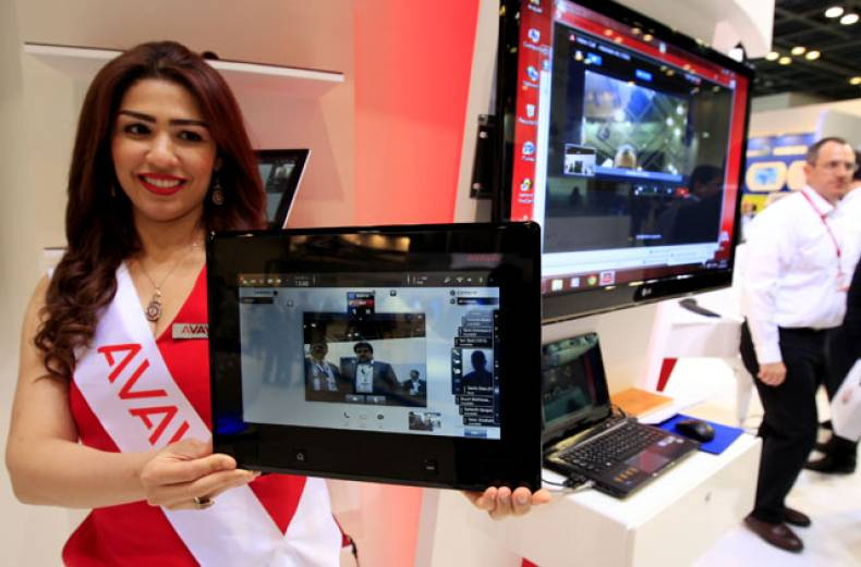 a-model-promotes-an-avaya-product-during-the-gitex-technology-week