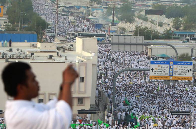 a-pilgrim-takes-a-photo-as-pilgrims-head-towards-mount-mercy-on-the-plains-of-arafat
