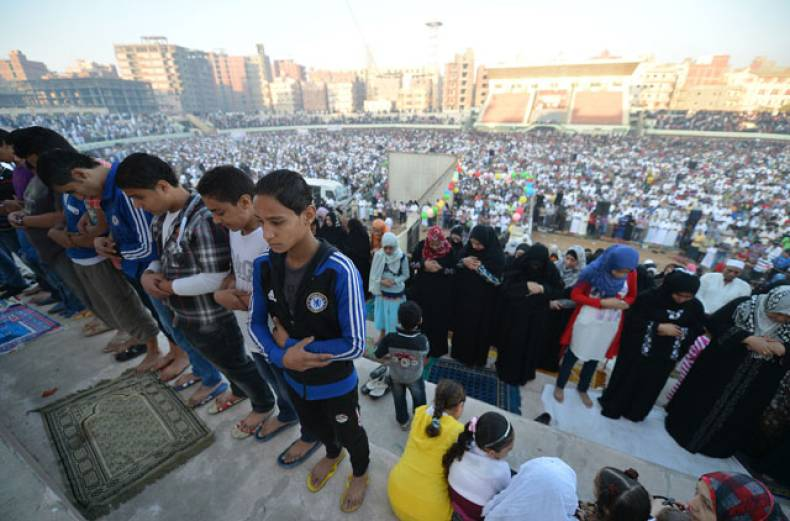 egyptian-muslims-attend-morning-prayer-at-a-football-stadium-in-the-nile-delta-city