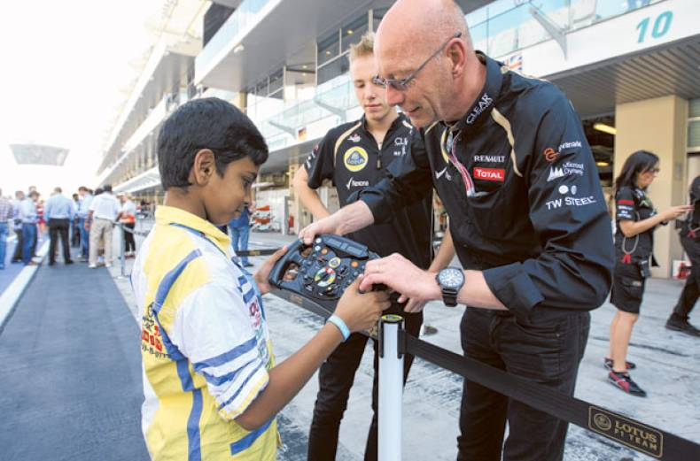 a-young-fan-gets-the-feel-of-the-driving-machine-on-the-pit-lane-at-yas-marina