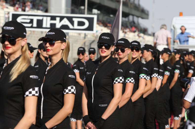 grid-girls-pose-prior-to-the-final-race-of-the-formula-one-abu-dhabi-grand-prix-2012