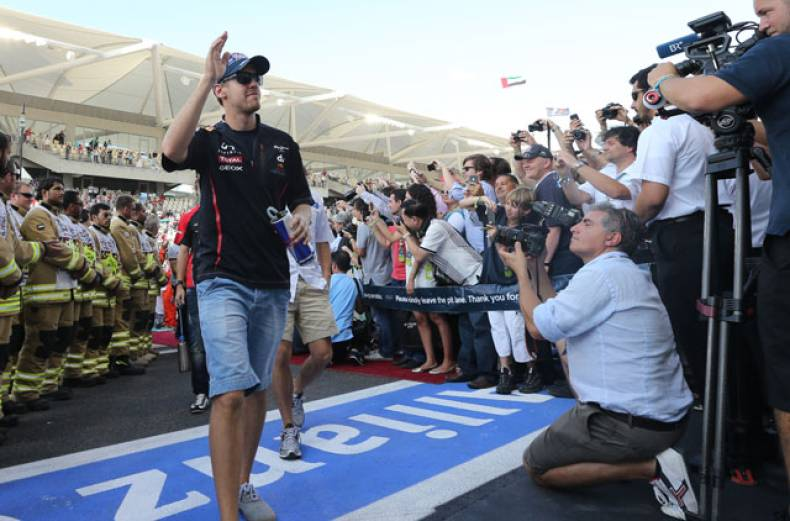 red-bull-driver-sebastian-vettel-of-germany-arrives-at-the-yas-marina-circuit